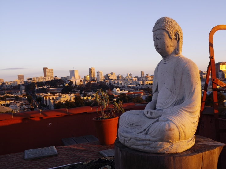 Rooftop sunrise with Buddha